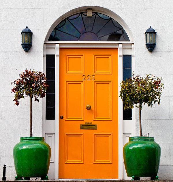 yellow-front-door-green-flower-pots