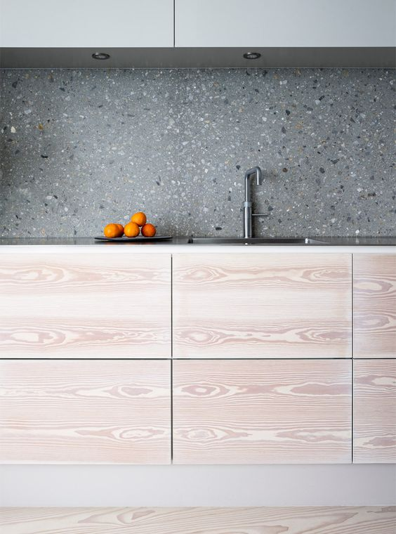 07-grey-terrazzo-kitchen-backsplash-contrasts-the-light-colored-cabinets