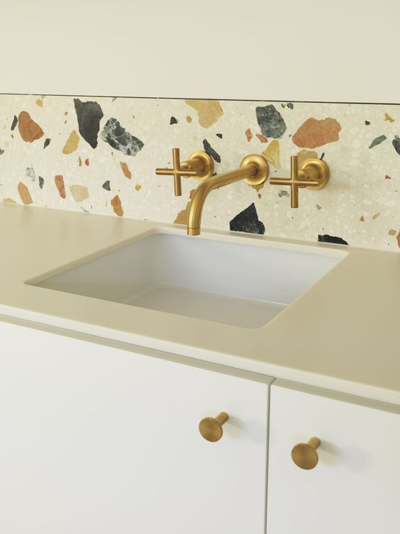 10-white-terrazzo-with-large-colored-inserts-as-a-backsplash-for-a-white-kitchen